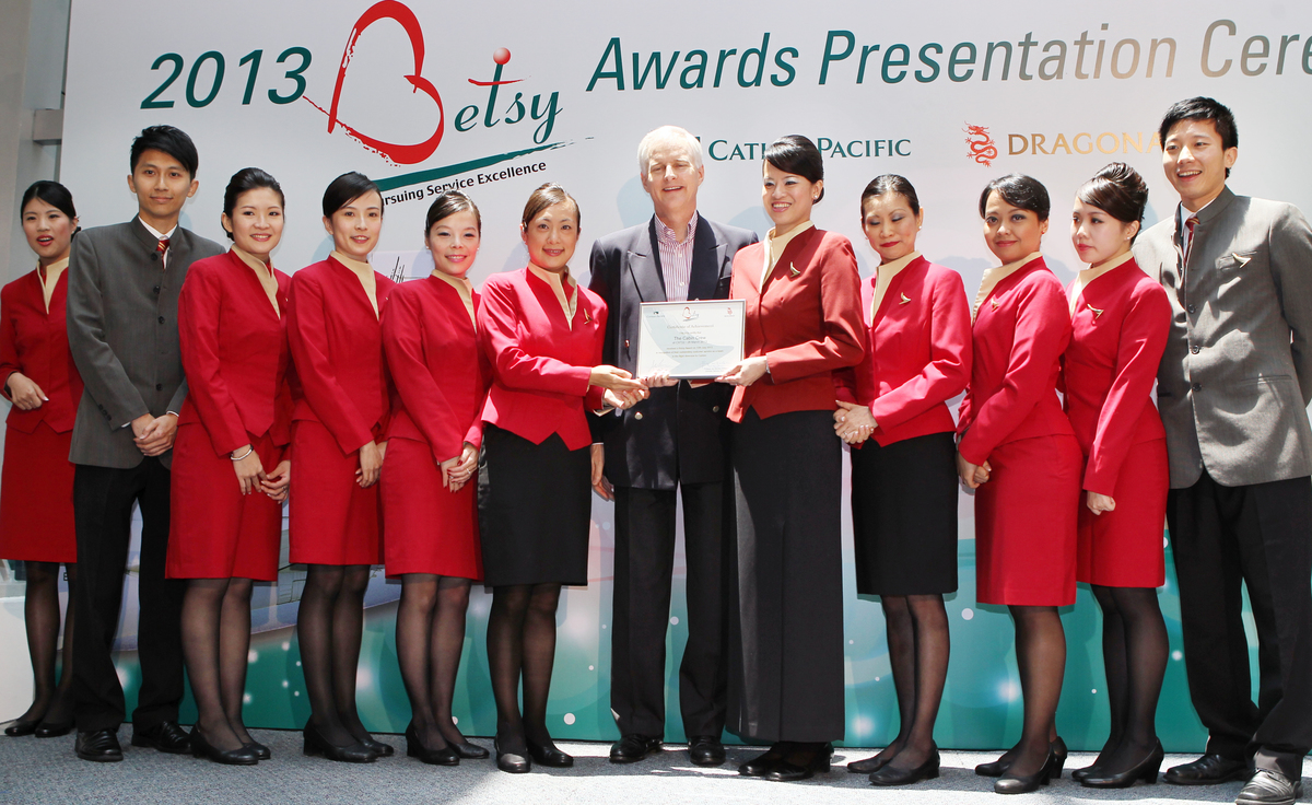 The cabin crew of Cathay Pacific's CX722 received a Betsy Award in recognition of their performance in the flight diversion to Canton from the airline's Chief Executive John Slosar (centre) in Cathay City, Chek Lap Kok. 12JUL13