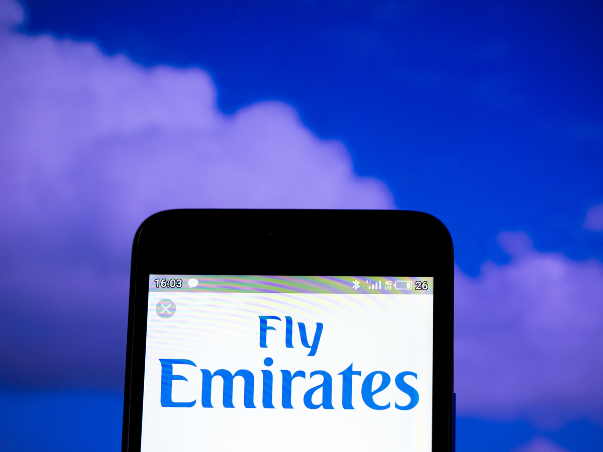 In this photo illustration the Emirates Airlines logo is...