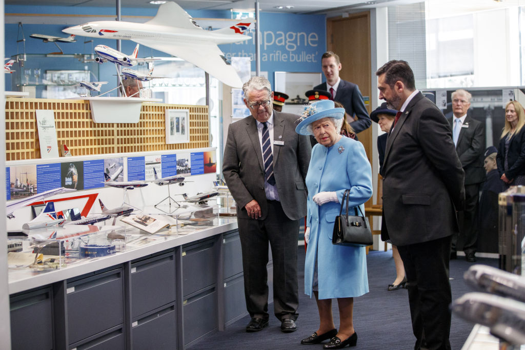 Queen Elizabeth II looks at exhibits in the Heritage Centre during her visit to the headquarters of British Airways in Heathrow