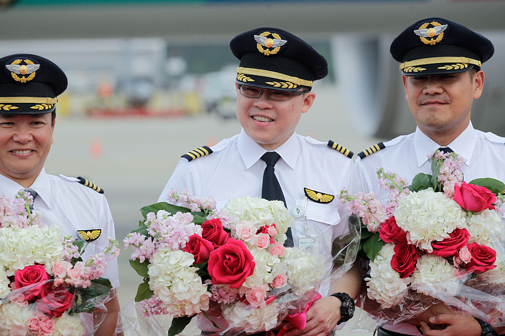 EVA Airways Chairman, and pilot, center, during the EVA Air Hello Kitty Shining Star Jet - Inaugural Event