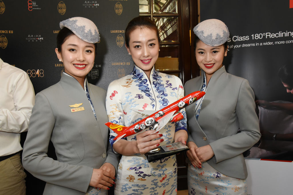 Models wearing Hainan Airlines stewardess uniforms