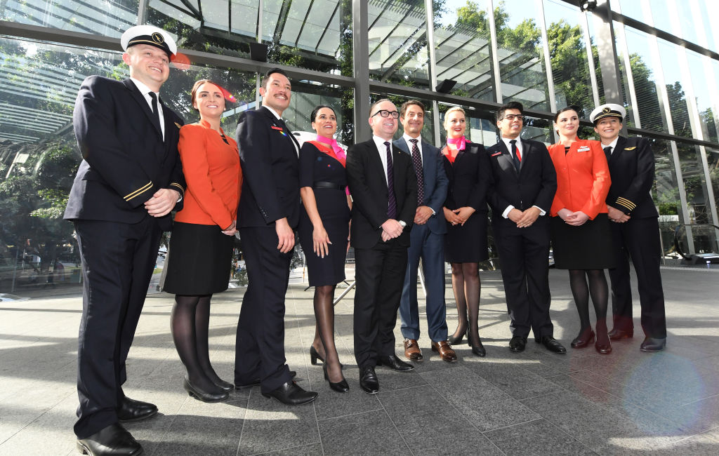 Alan Joyce, CEO of Qantas (centre with glasses) with team members