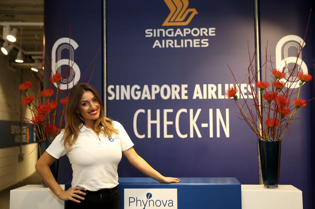 a member of staff at the Singapore Airlines check in desk