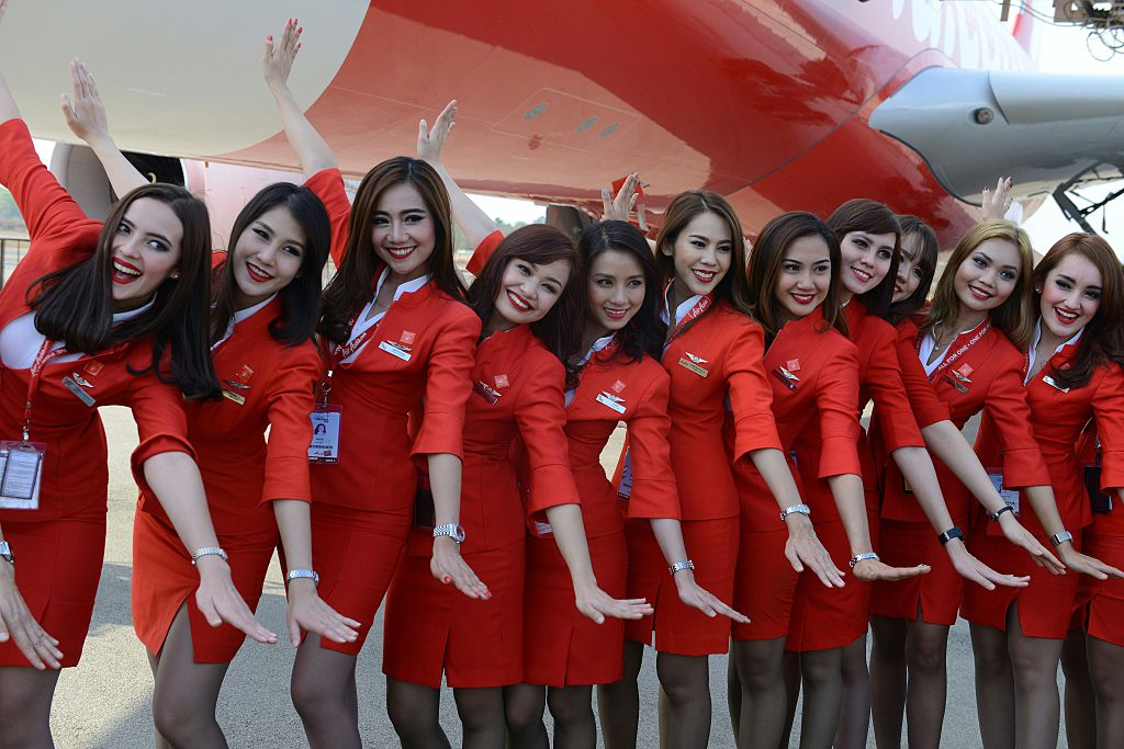 Air Asia cabin crew pose at The India Aviation 2016 airshow