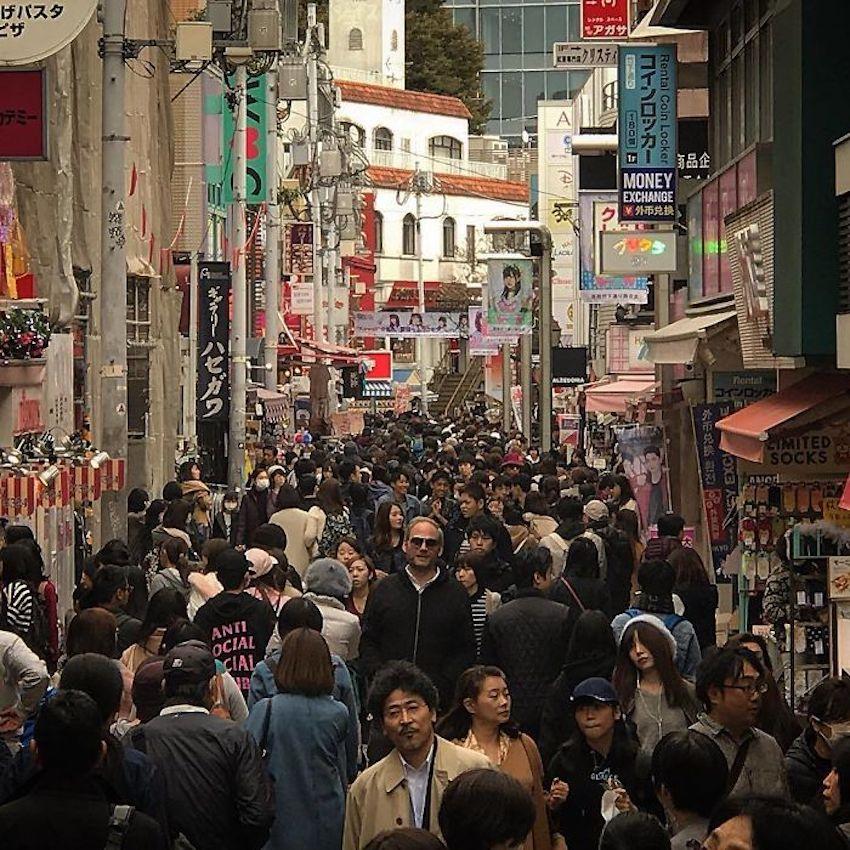 tall guy walking in japan
