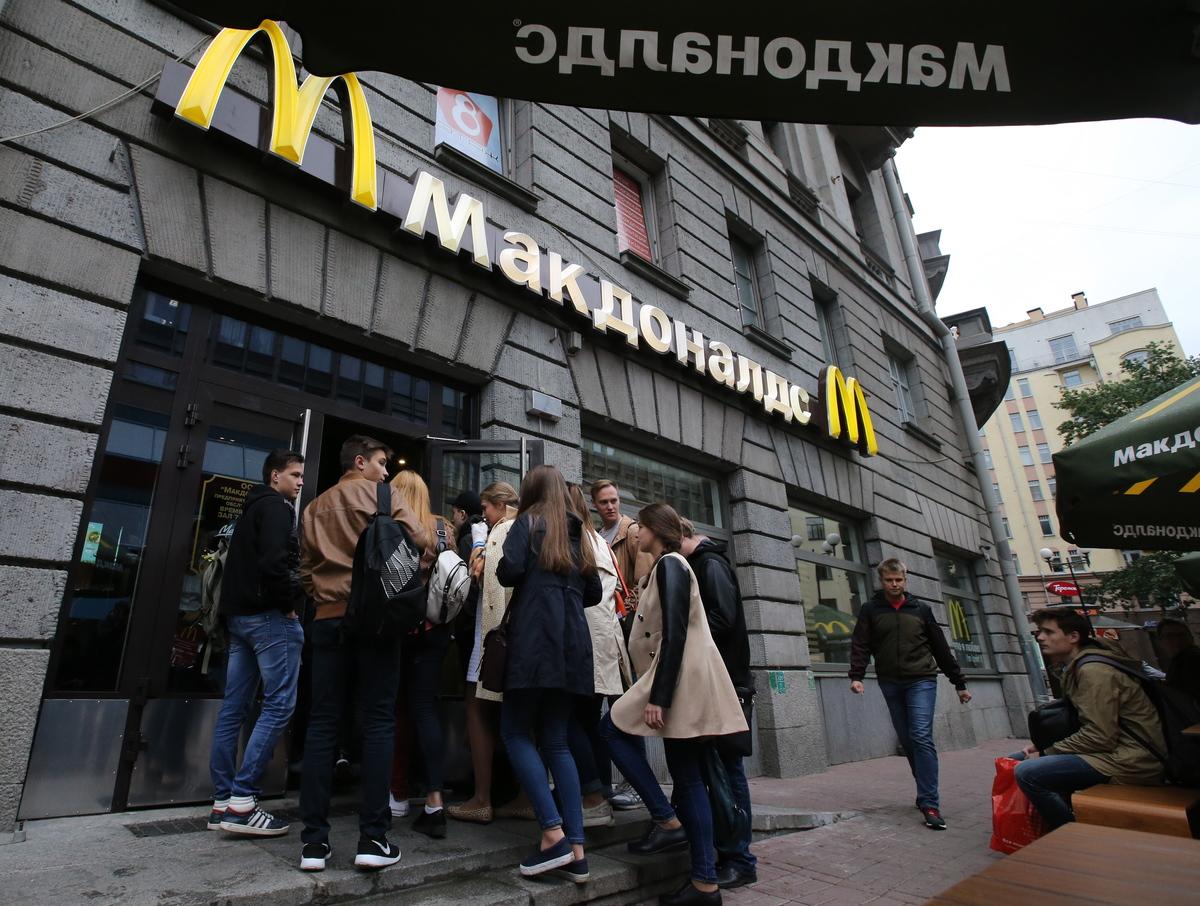 Customers at McDonald's fast food restaurant in Kamennoostrovsky Prospekt Street.