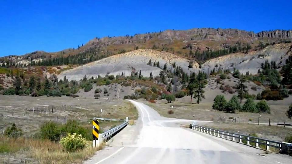 a road winding through hills in Dulce, New Mexico