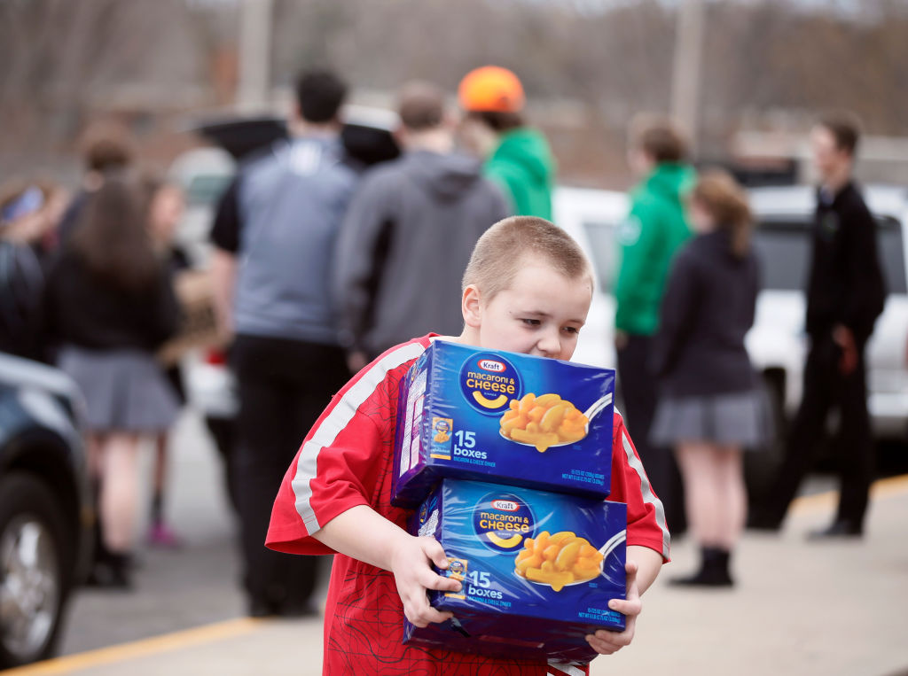 child carrying cases of mac n' cheese