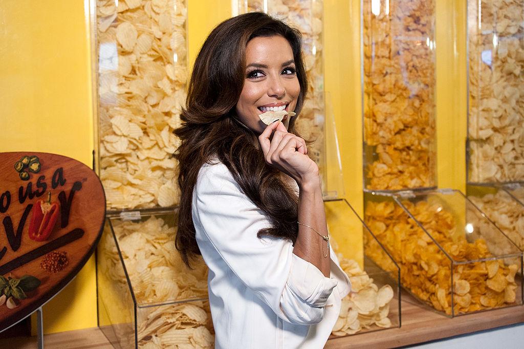 celebrity posing with a potato chip