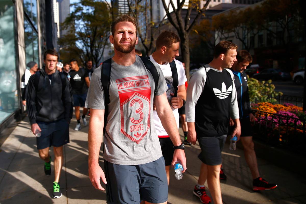 Kieran Read of the New Zealand All Blacks takes in a bit of sightseeing as they walk along Michigan Ave following a pool recovery session on October 27, 2014 in Chicago, Illinois.