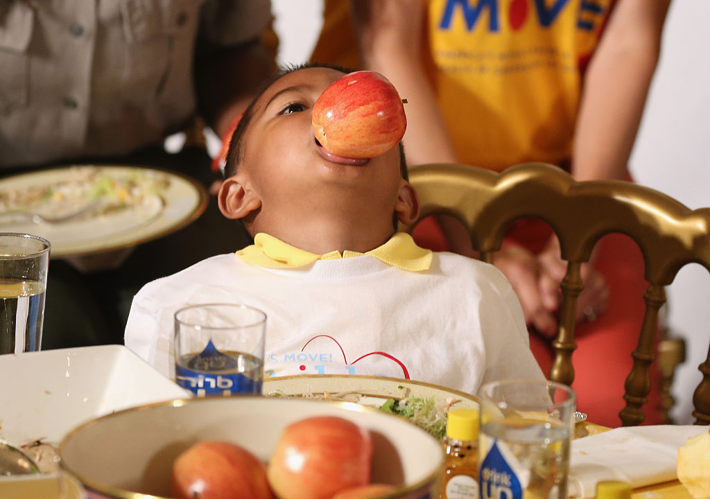 a child with a shiny apple