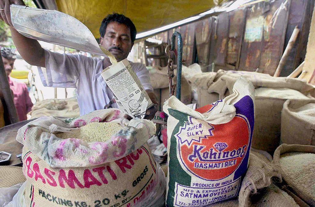 man scooping rice