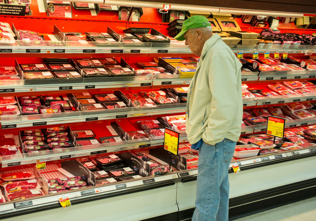 man buying meat at the store
