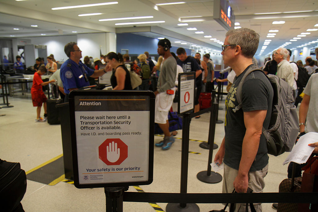 Miami International Airport, security screening queue.