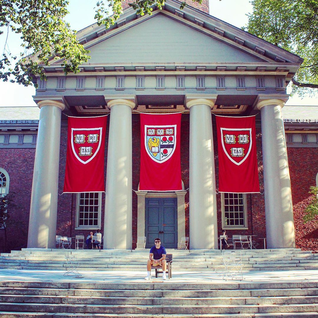 kid sitting on harvard steps