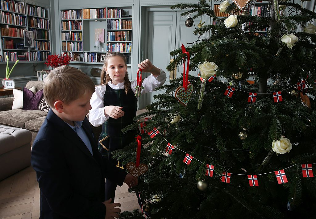 Norway's Prince Sverre Magnus and Princess Ingrid Alexandra pose during a Christmas photo