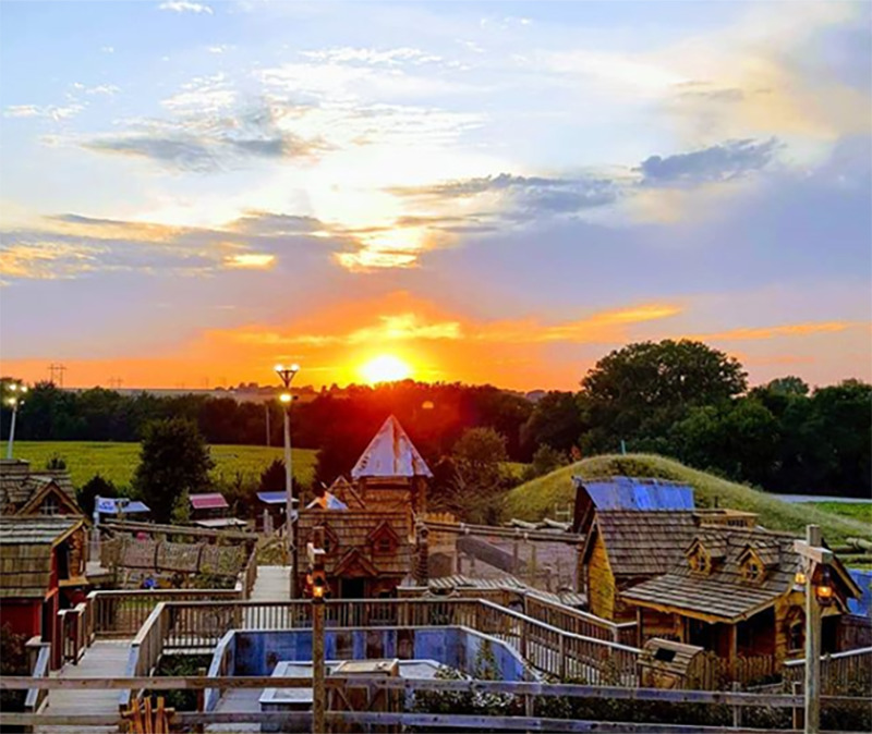 The patch's village-like structures are seen overhead at sunset
