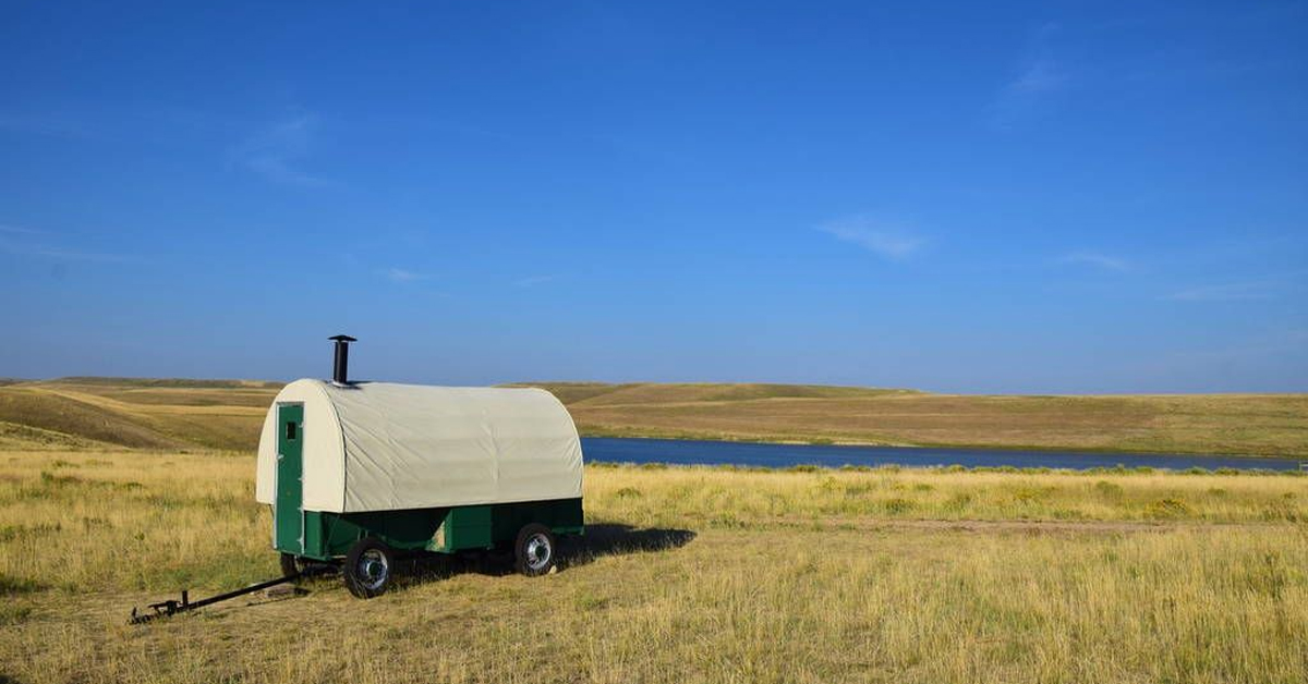 a sheep wagon on the grass in wyoming