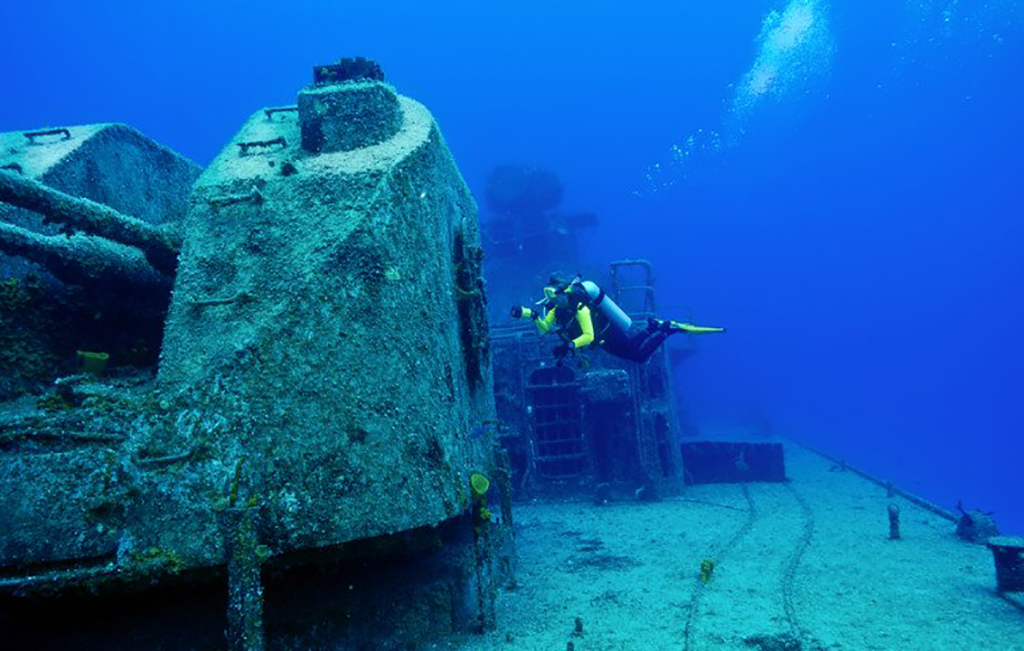 Diver next to vessel