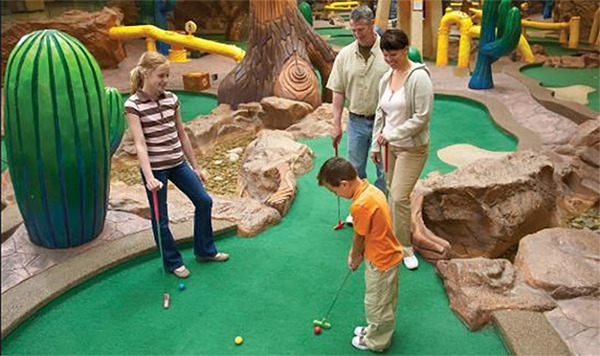 A family plays mini golf inside of the West Edmonton Mall