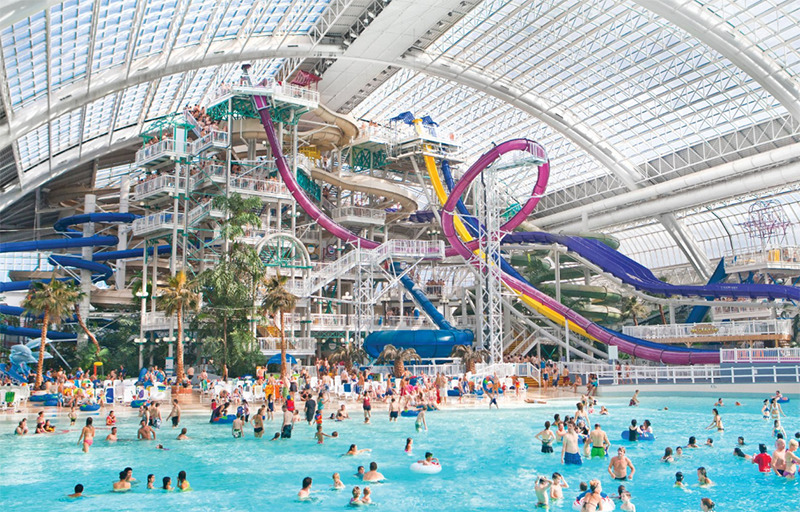 An indoor water park features an enormous waterslide structure