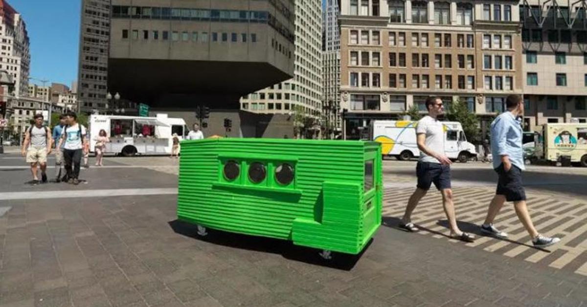 a rectangular green box on a busy street