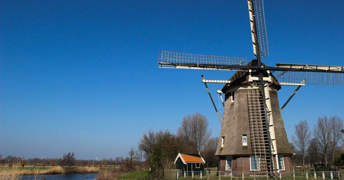 a windmill in the countryside near amsterdam
