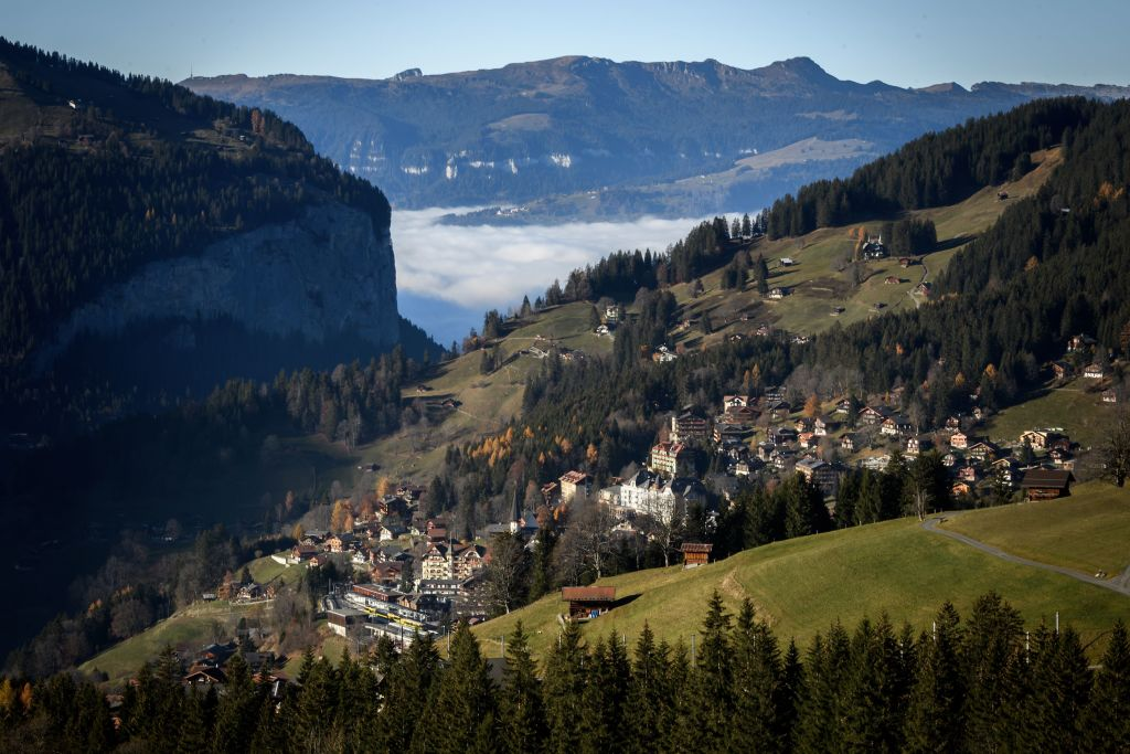 Paragliding Through The Tourist Town Of Wengen, Switzerland
