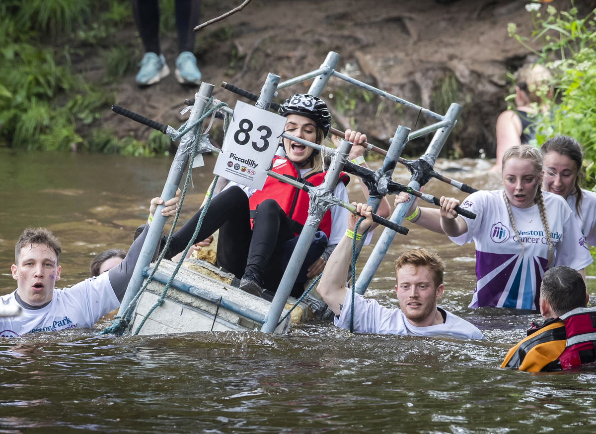 Competitors cross the River Nidd as they take part in the Great Knaresborough Bed Race.