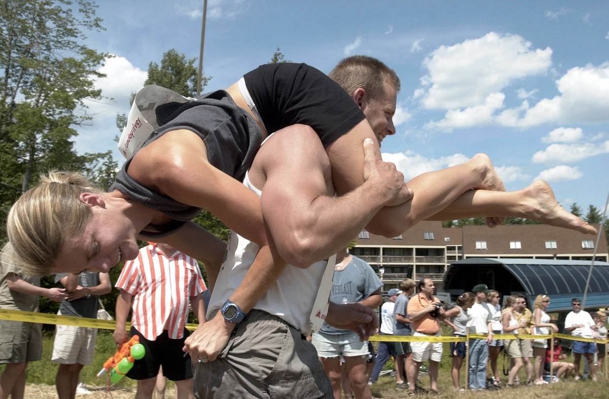 Contestants compete in the annual North American Wife Carrying Championships