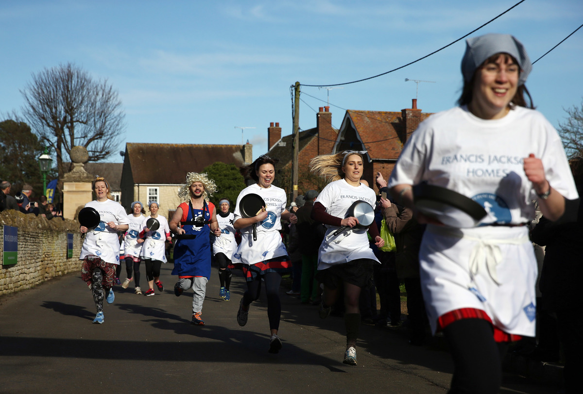 Competitors take part in the annual pancake race.