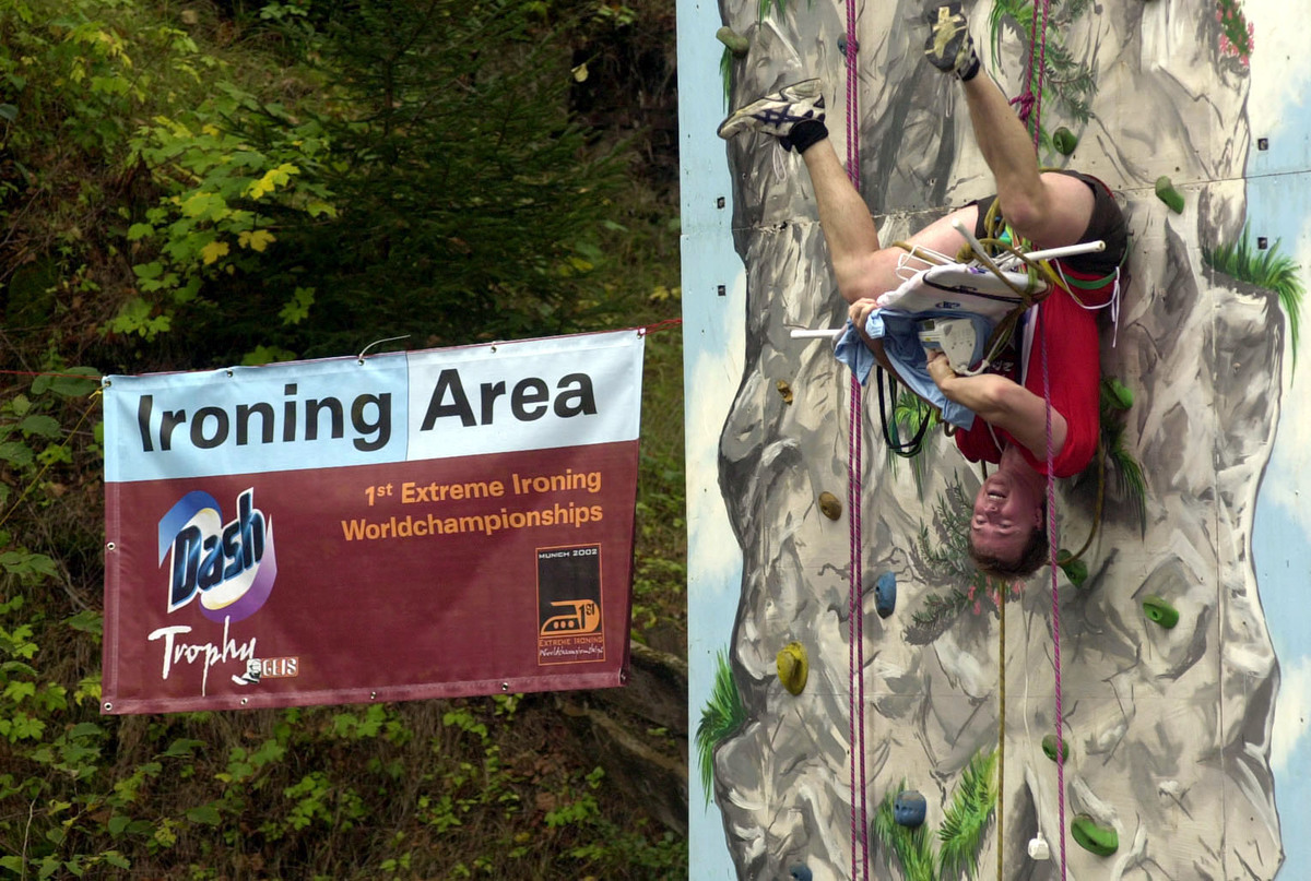 David Jeanson, a Product Manager for Rowenta, irons a shirt upside-down during the rocky section of the Extreme Ironing World Championships