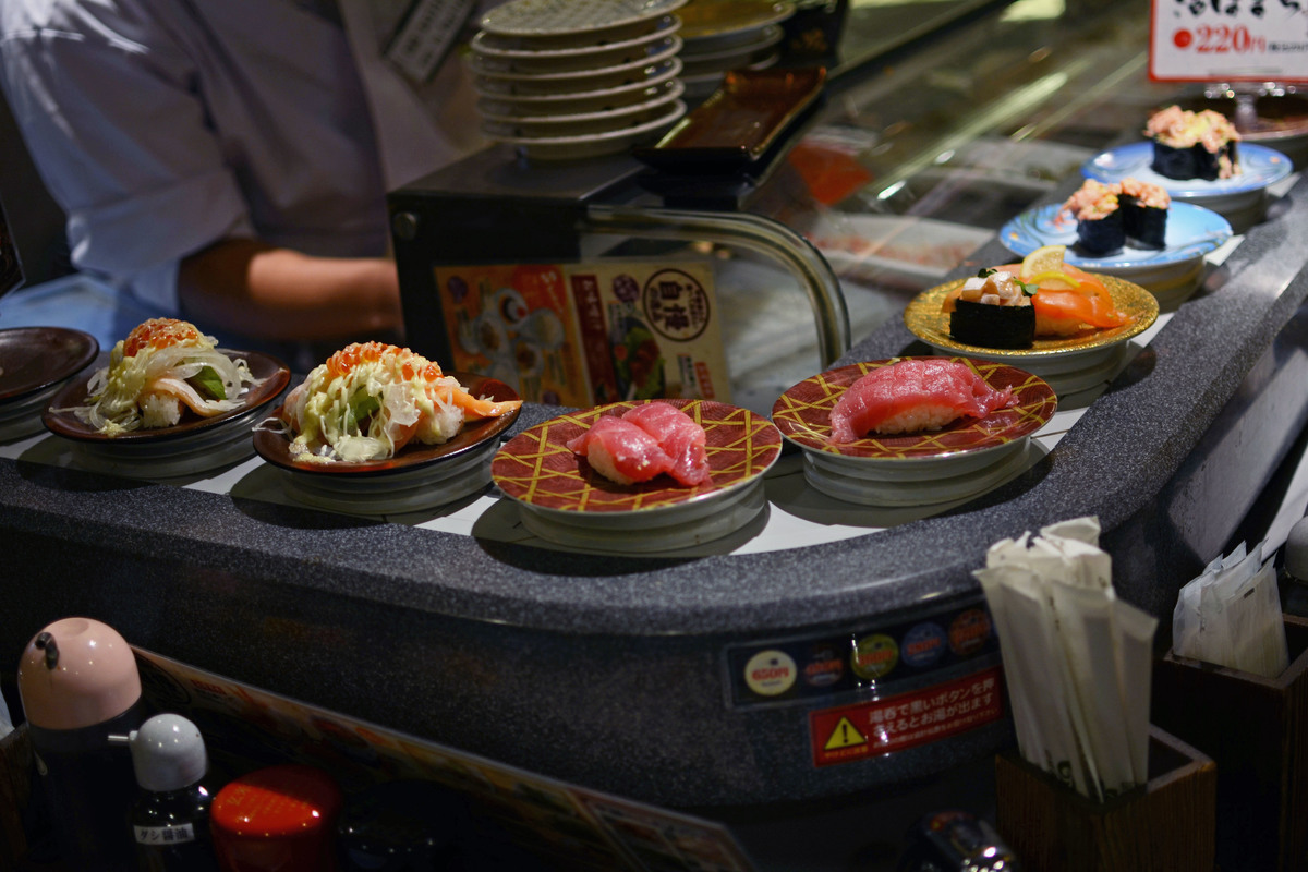 Sushi sits on a rotating bar in a restaurant in Tokyo.