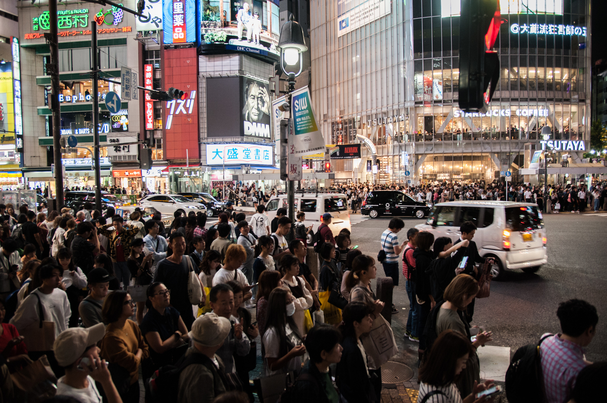 Crowds wait at Shibuya Crossing, Tokyo, the busiest pedestrian crossing in the world.