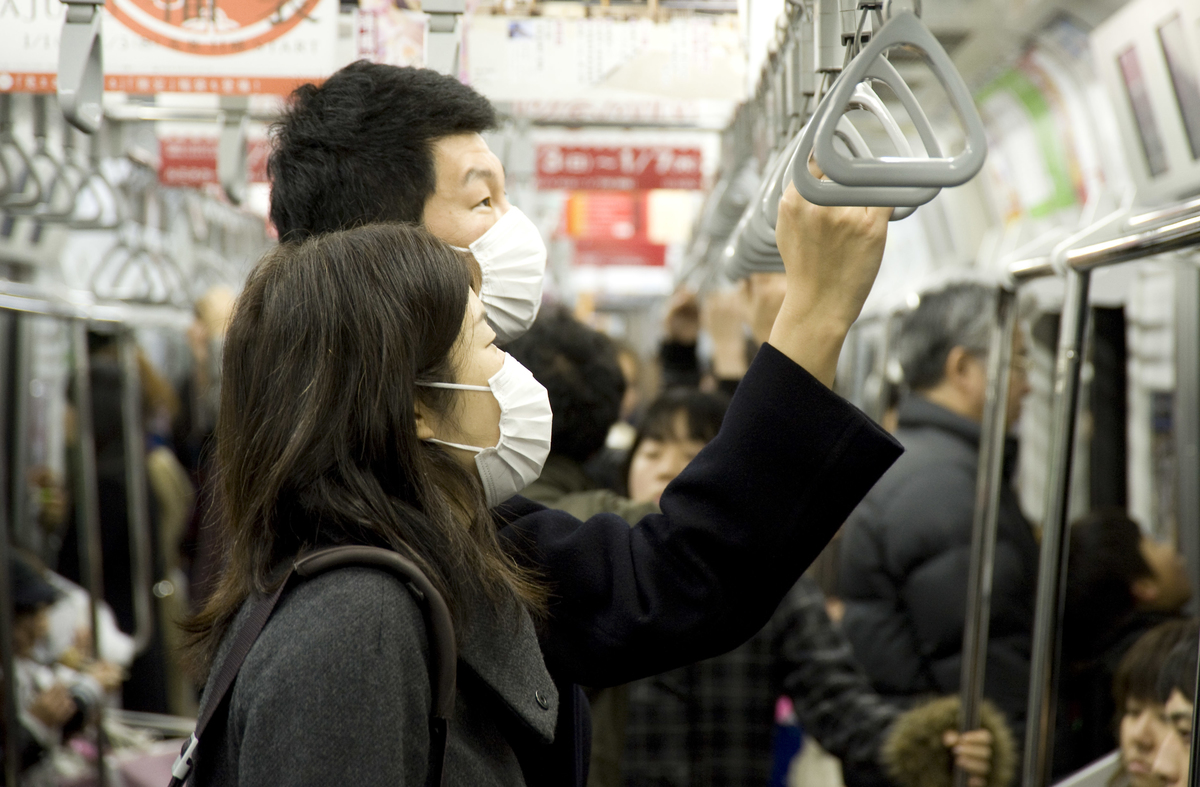 Passengers wearing face masks ride the train in Tokyo, Japan.