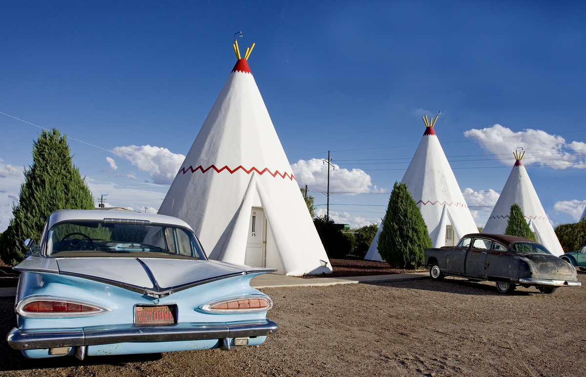 The Wigwam Motel along Route 66 features teepees and antique cars.