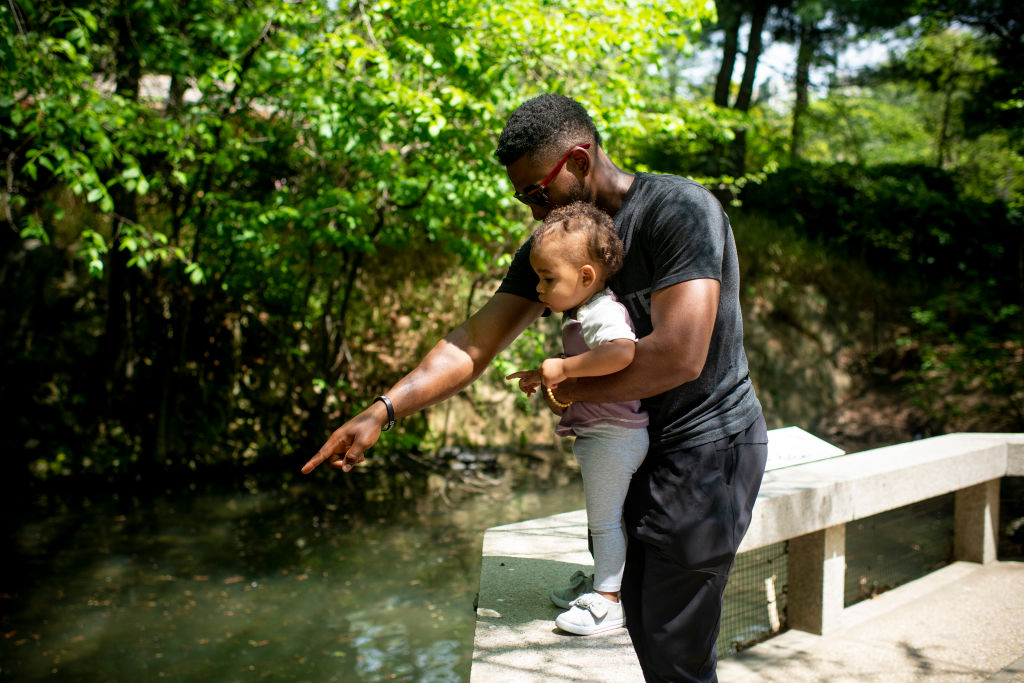 a dad and child at the central park zoo