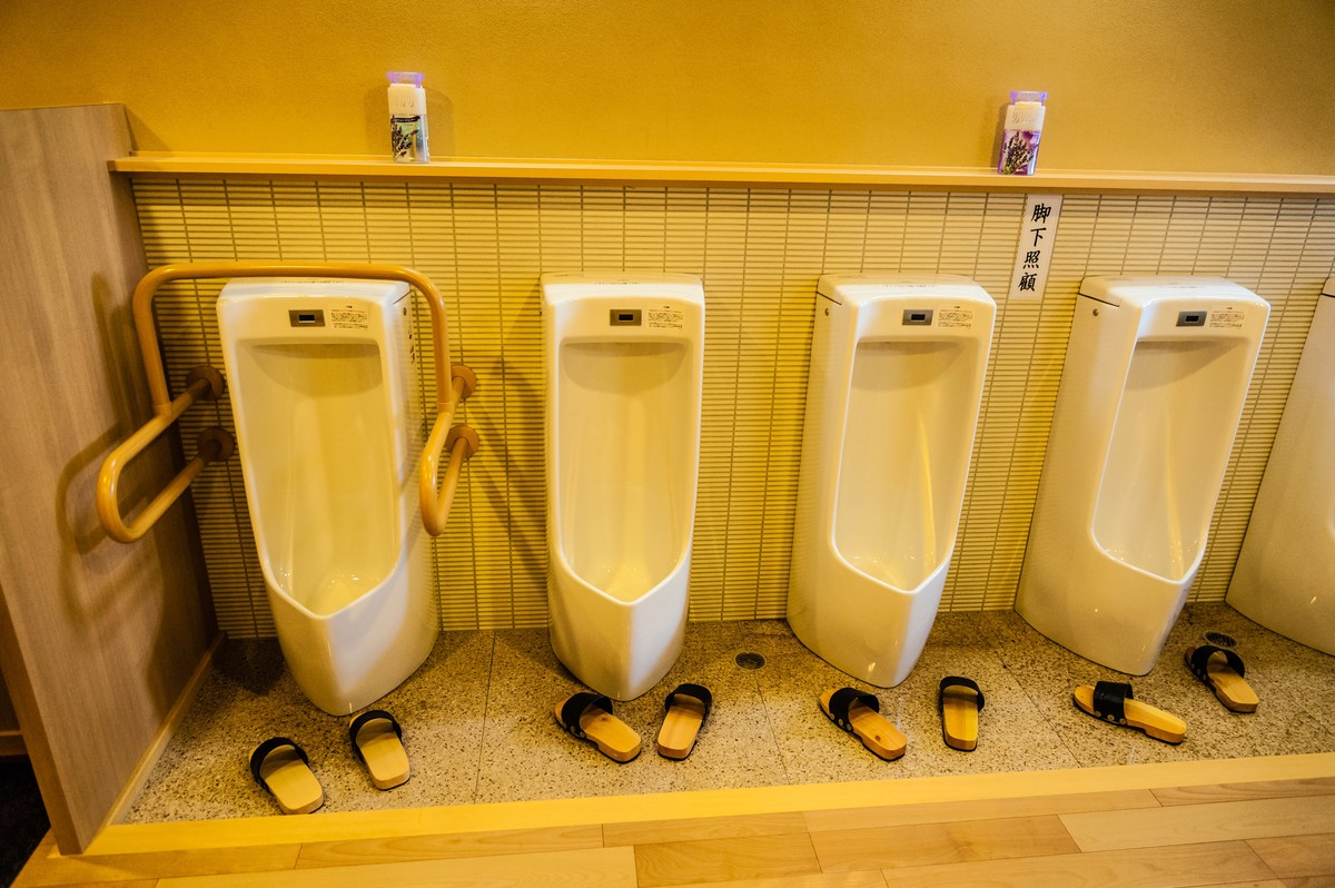 Toilets line a bathroom wall in the Tenry-ji temple.