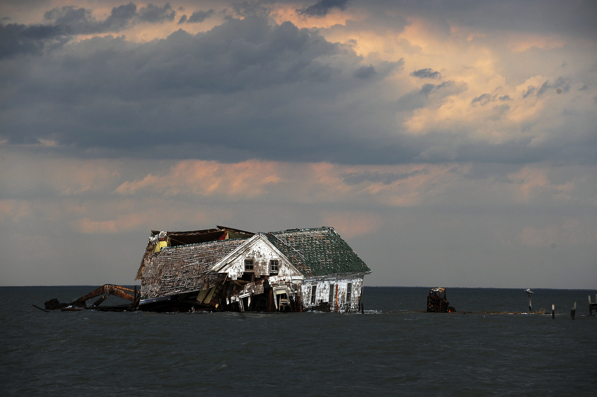 The last house on Holland Island collapses from erosion.
