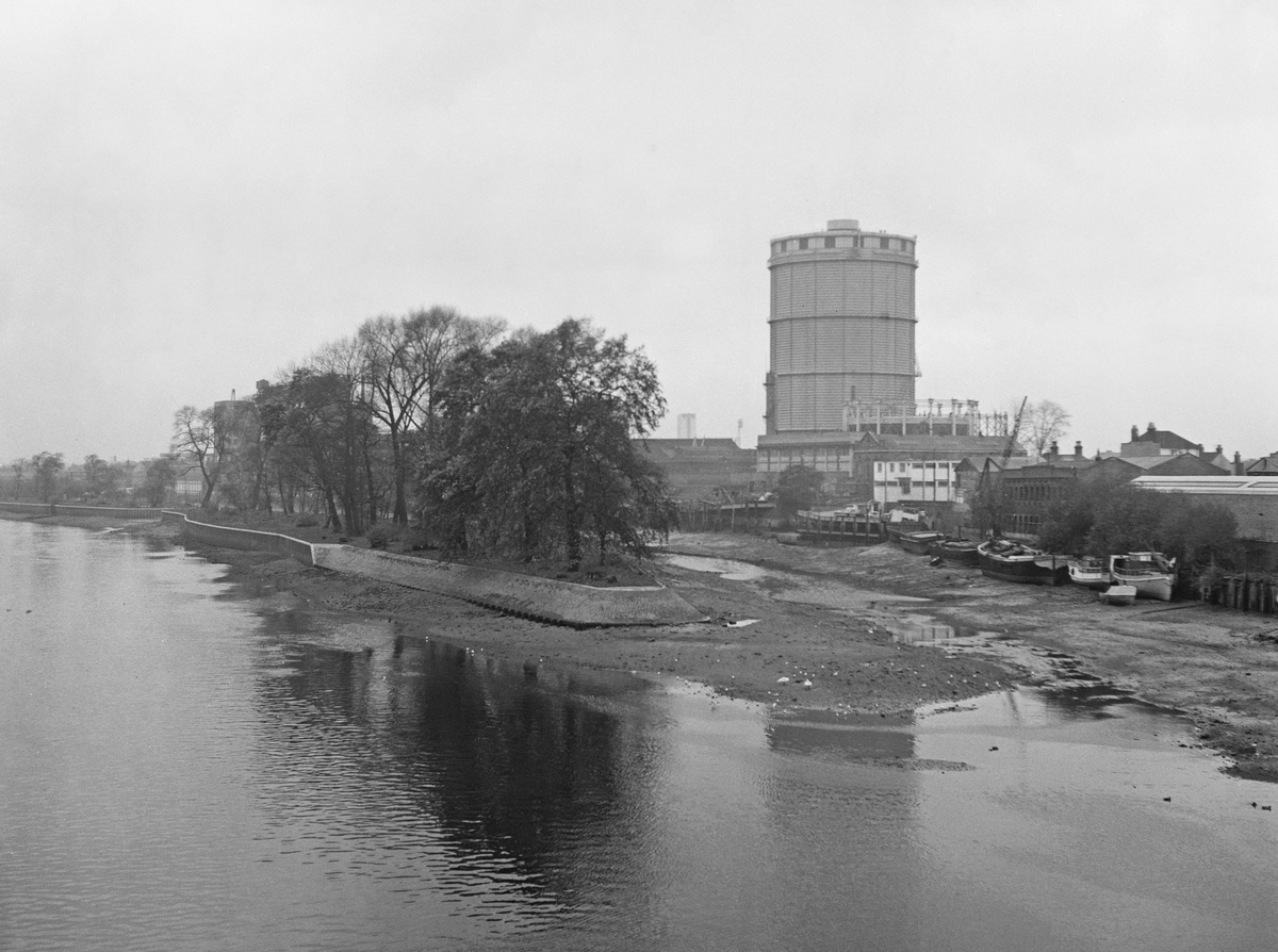 View from Kew Bridge shows north bank of the River Thames with Brentford Ait in the center, 1964.