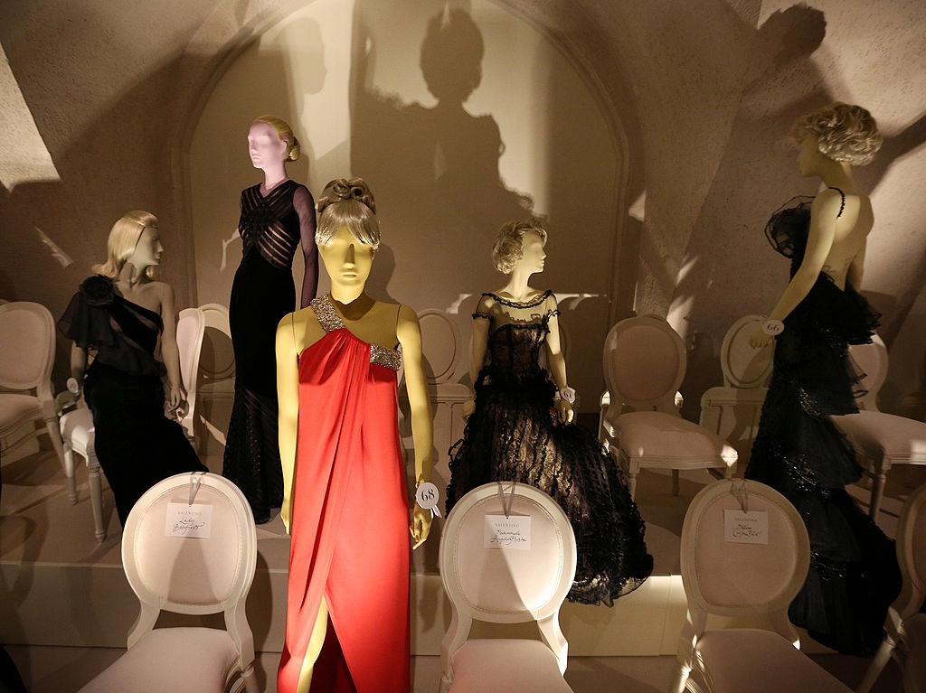 Various mannequins are photographed in evening gowns.