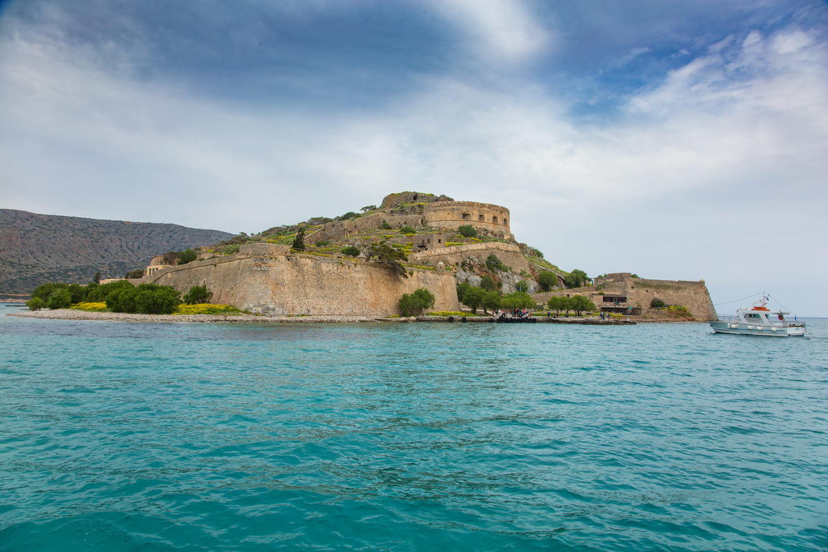 Spinalonga, an abandoned leper colony in Crete island, is seen from the sea.
