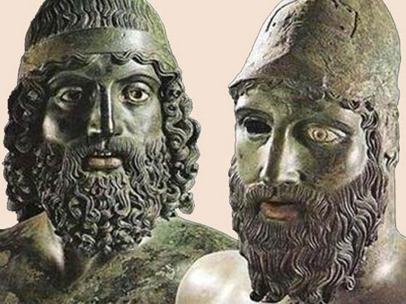 The faces of both statues are male warriors.