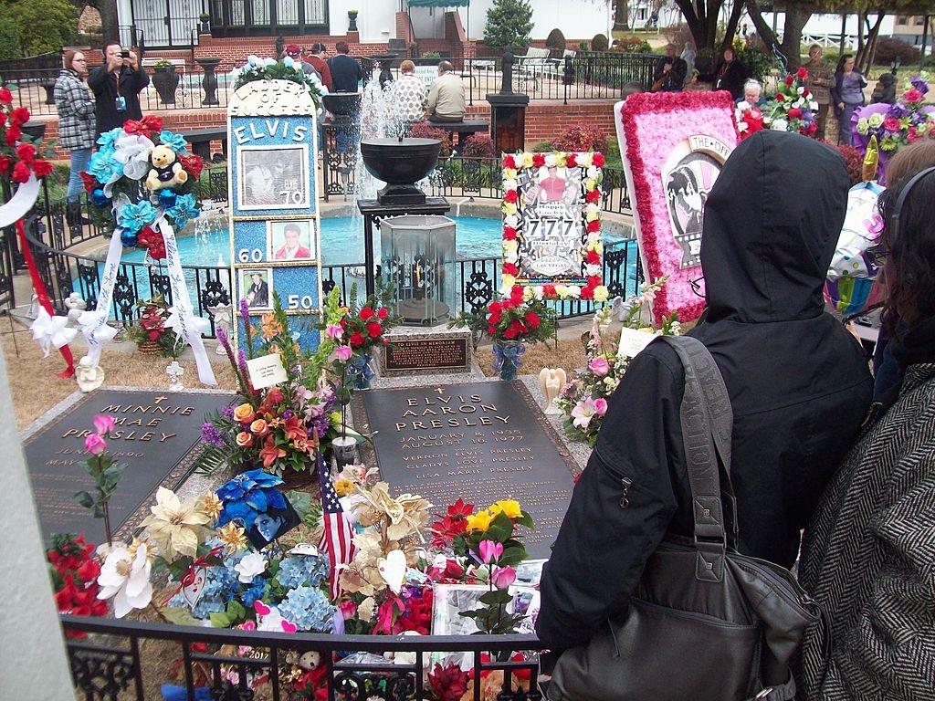 Elvis Presley fans leave mementos at his grave at the Graceland Mansion