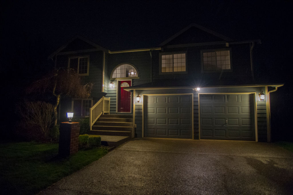 Light illuminate the front of a home at night.