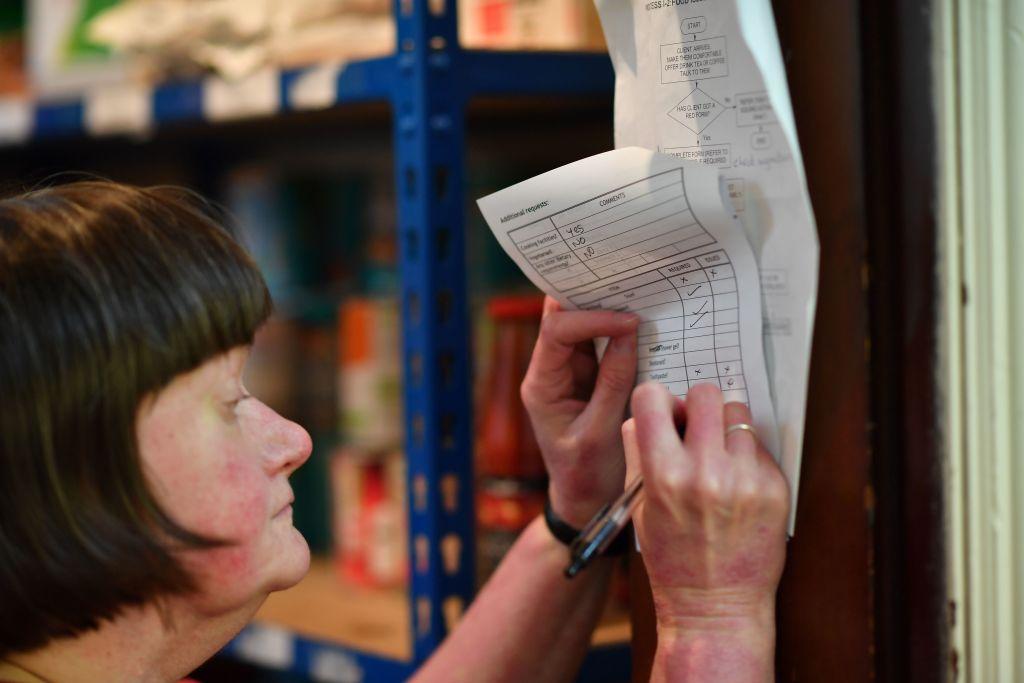 A woman marks a checklist.