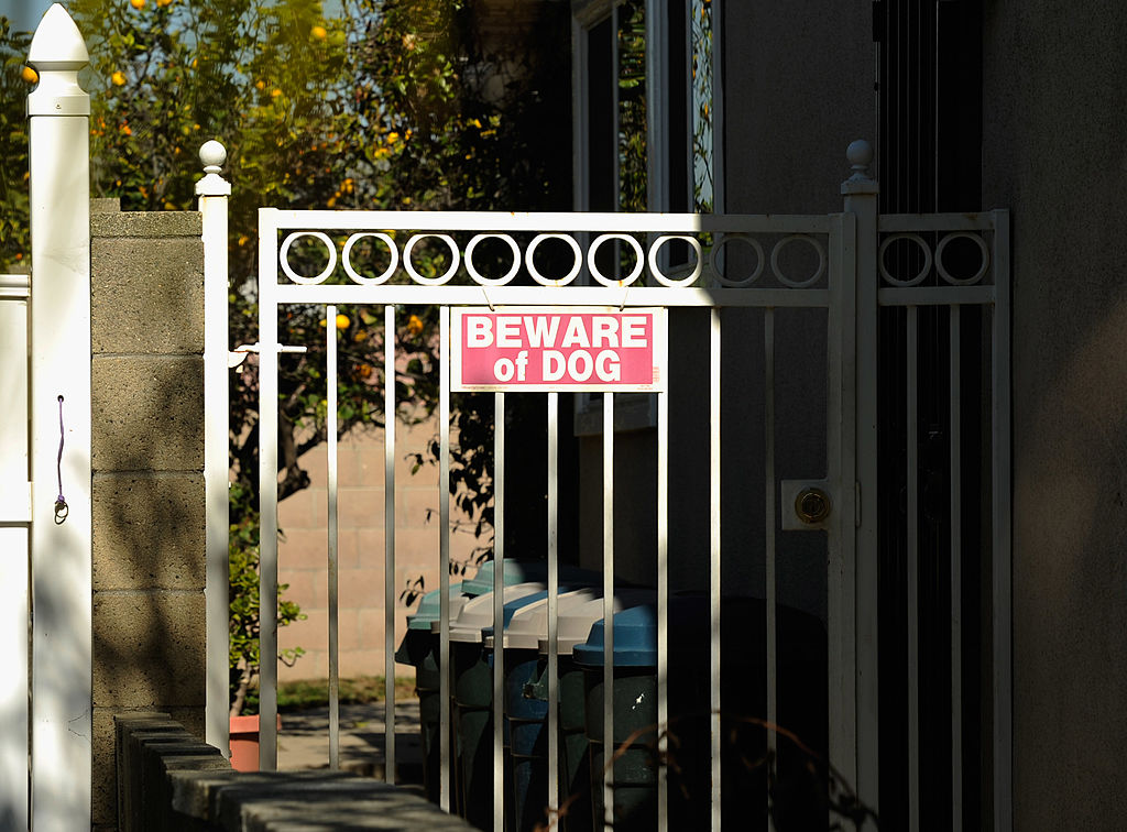 A gate sign reads