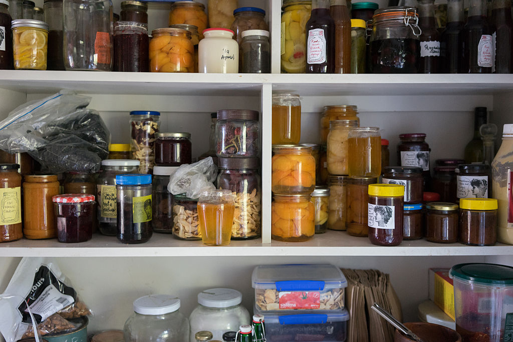 Items sit on kitchen shelves.