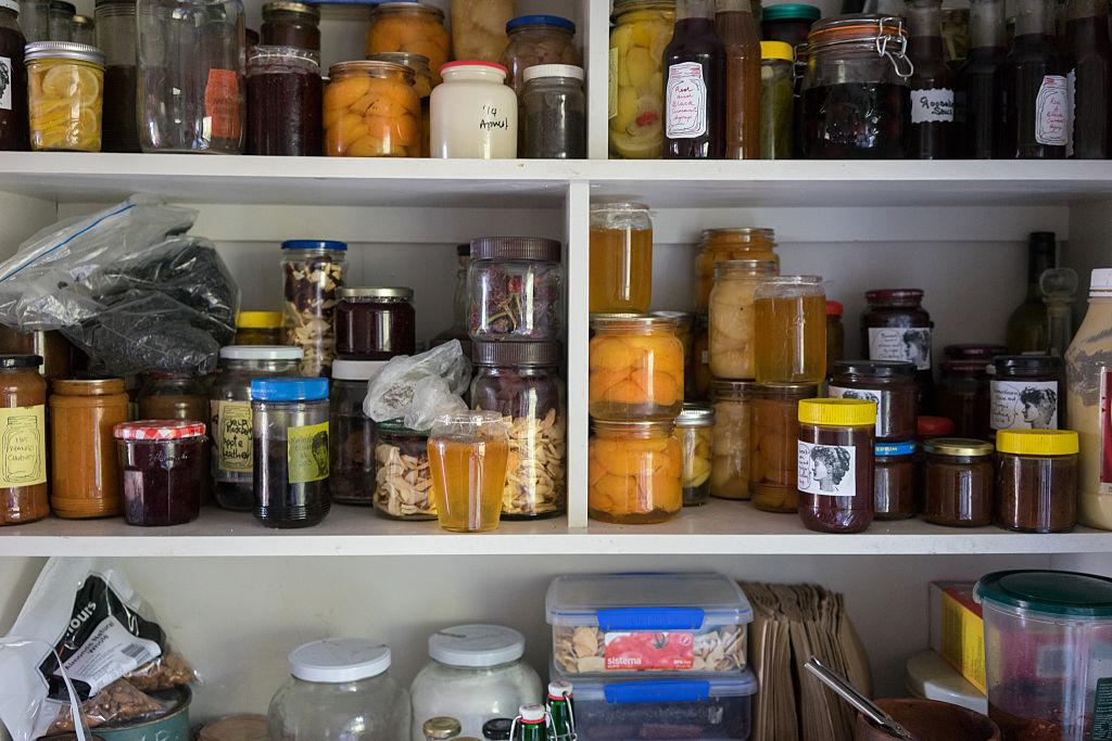 Items sit on kitchen shelves.