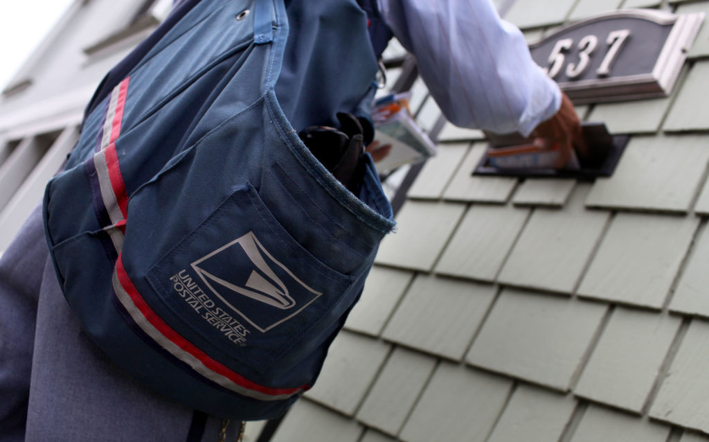A postal worker delivers mail.